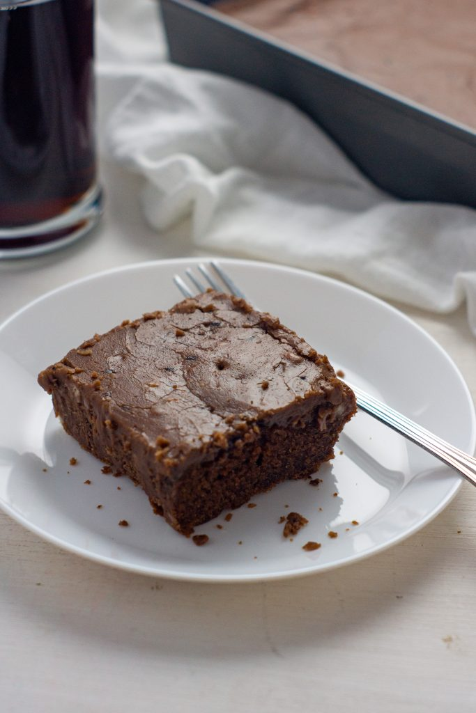 If you are craving Cracker Barrel Chocolate Coca-Cola Cake but want to enjoy it at home, you have to make this easy copycat Chocolate Coca Cola Cake recipe. Rich and moist, with the most amazing homemade frosting, this cake is a one of a kind delicious treat.