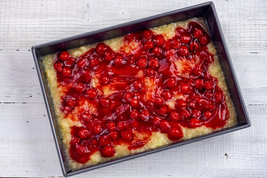 pineapple and cherry in a pan