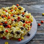 This popcorn cake recipe is a super simple and quick treat that you can make with the kids. The main ingredients of this fun Popcorn Cake are popcorn and candy. It is a wonderful mix of so many flavors. This delicious and super fun Popcorn Cake is a great choice to make and gift to friends and family.