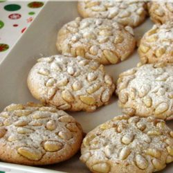 Pignoli cookies also known as pine nut cookies is a macaroon typical of Sicily, Italy. It is a very popular Italian cookie and holiday cookie recipe. Pignoli cookies are made with almond paste and pine nuts, but no flour.