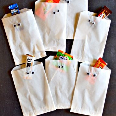 Trick-or-treaters and Halloween party guests will be in for a sweet surprise when candy is presented in these spooky Halloween treat bags. These simple DIY Halloween projects and Halloween Candy Cookie Bars are sure make your celebration extra special.