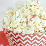 White chocolate, popcorn and festive sprinkles make the perfect holiday popcorn mix. This simple to prepare holiday popcorn is sure to be a hit at your holiday gatherings.