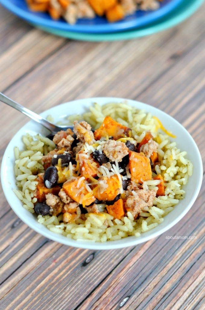 A savory and hearty dinner served in a bowl – turkey and sweet potato burrito bowls. It's a mouth-watering meal with a bit of kick hanks to chipotle chili powder, cilantro, cumin and lime.