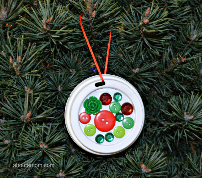 Use your recycled coffee cup lids to make this festive Christmas ornament.