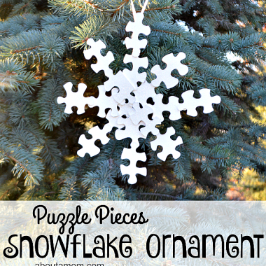 Do you have puzzles laying around mixing pieces? This is a great Snowflake Christmas Ornament you can make with your kids using those pieces.