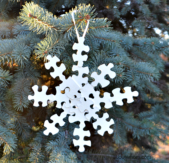 Snowflake Christmas ornament made from puzzle pieces.