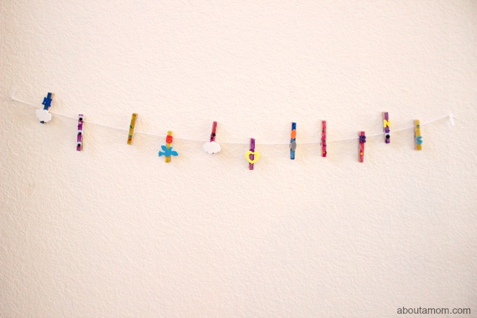 Display your child's art work with this fun and easy-to-make clothespin art gallery.