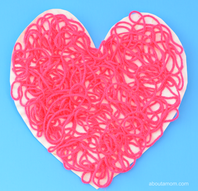 Valentine Heart Craft for kids using yarn and paper plates.
