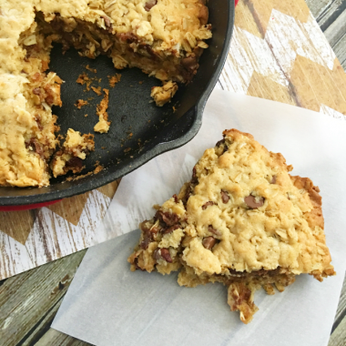 A seriously delicious oatmeal chocolate chip cast iron skillet cookie recipe.