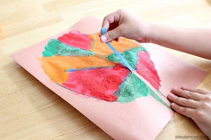 Tape Resist Leaf Painting with kids, remove tape