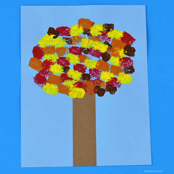Bring the beautiful colors of fall alive in this sponge painted fall tree kid craft.
