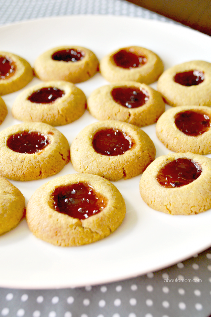 Cornmeal Thumbprint Cookies made with Smucker's Fruit & Honey™ Strawberry Jalapeño Fruit Spread are wonderfully sweet and savory, and a clever twist on the classic jam-filled thumbprint cookie.