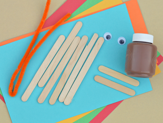 Popsicle stick turkey craft for kids to make this Thanksgiving.