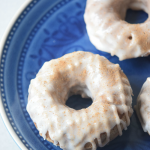 A recipe for delicious cinnamon dusted apple cider doughnuts with a sugar glaze.