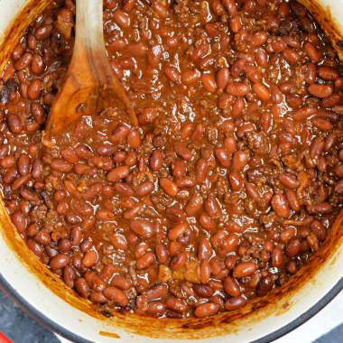 A delicious bean recipe made with ground beef, bacon, just the right amount of sweetness and a surprising smokey flavor. This BBQ Cowboy Beans recipe is the perfect side dish for tailgating and backyard barbecues.