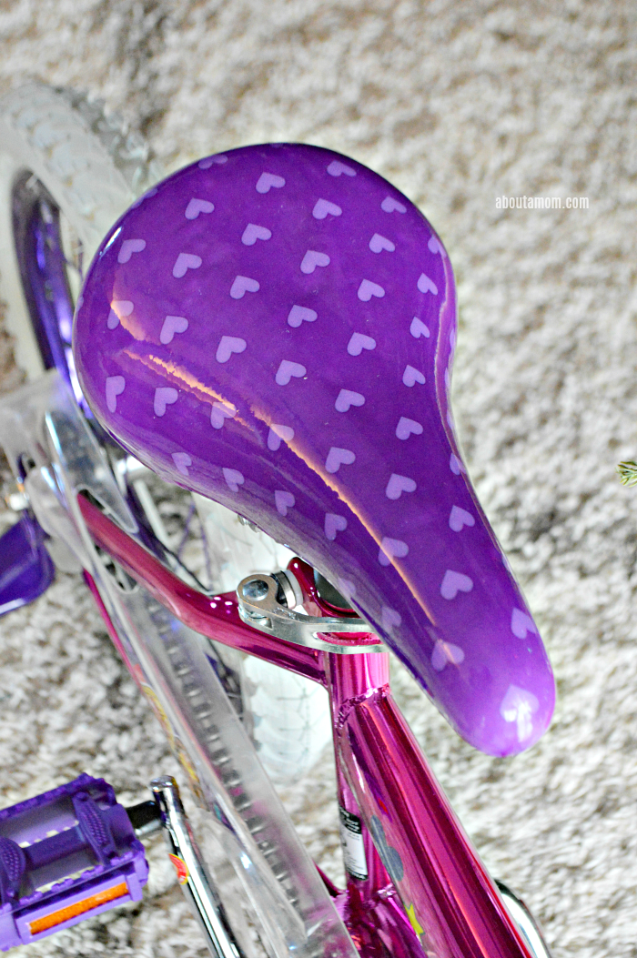 "Let her ride in style. The 16"" Barbie Girls Bike by Dynacraft, available at Walmart, is perfect for the little girls on your holiday shopping list."