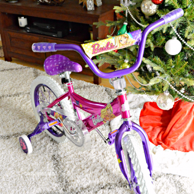 "Let her ride in style and give the gift of fun. The 16"" Barbie Girls Bike by Dynacraft, available at Walmart, is perfect for the little girls on your holiday shopping list."