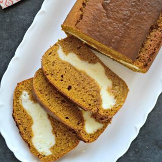 If you like pumpkin pie and cheesecake, you're totally going to love this cream cheese pumpkin bread. This cream cheese filled pumpkin bread is wonderful because it's not over-the-top decadent. It's just sweet enough, and goes perfectly with your morning coffee.