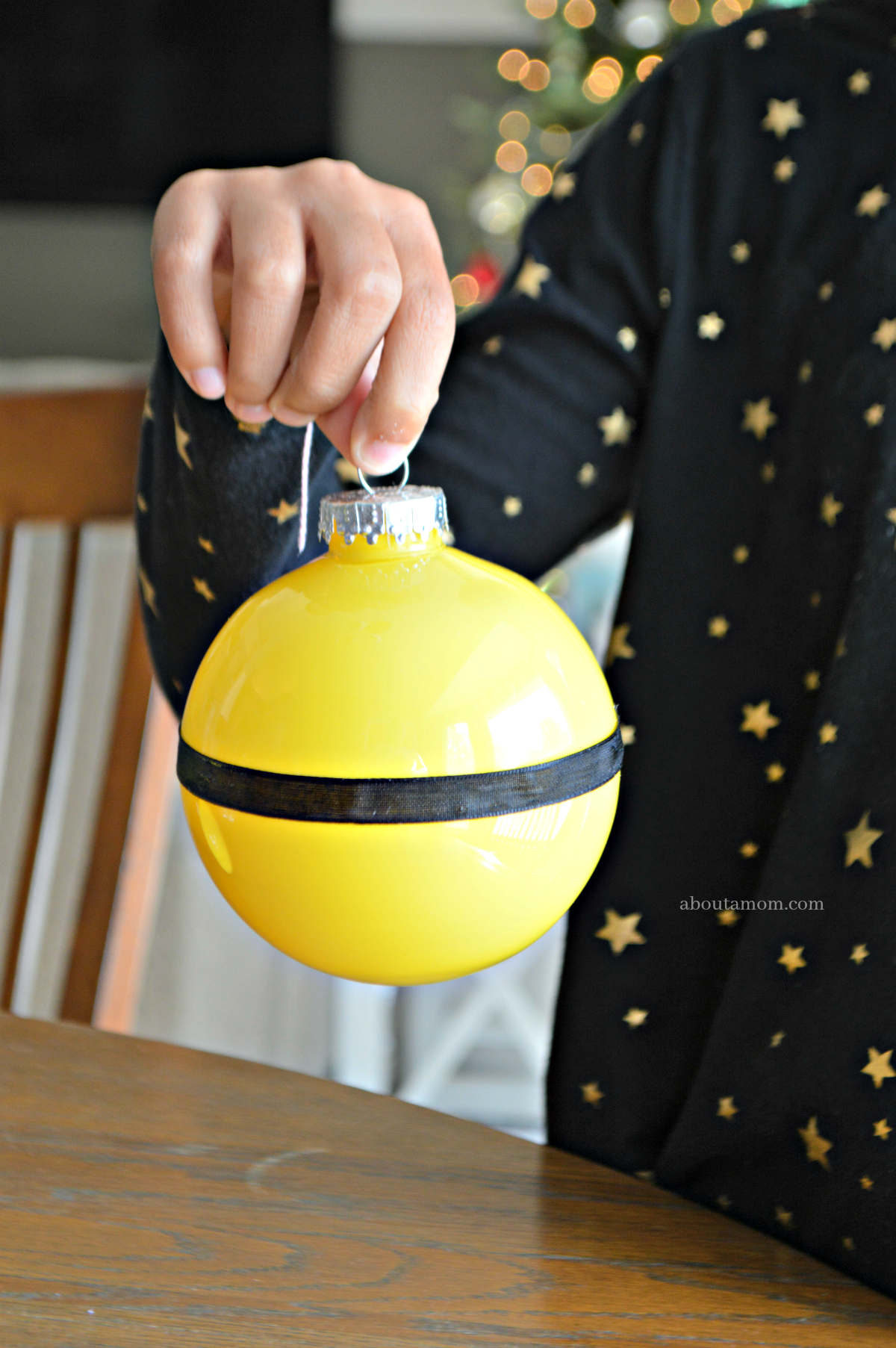 Plastic ball ornaments are used to make these DIY Minion ornaments that are a whole lot of fun and pretty easy to make. A Minion ornament that's perfect for Despicable Me fans young and old alike.