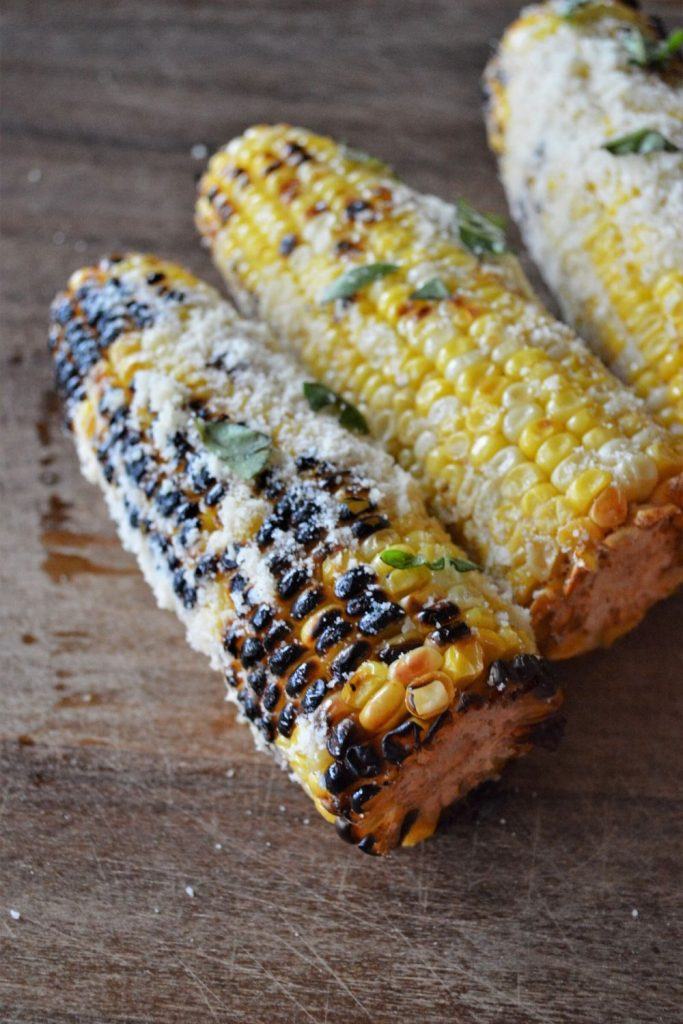 If you are looking for an amazing side dish, you have to try this Garlic Parmesan Grilled Corn. Butter, olive oil, garlic, fresh herbs and Parmesan cheese give this grilled corn the most incredible flavor. Whether you are making this recipe with dinner, or taking it to a picnic, everyone is going to love this corn.
