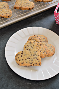 "Nothing says I love you like a warm from the oven chocolate chip cookie. Except, of course, when it comes in the shape of a heart. These heart shaped chocolate chip cookies are the perfect way to say ""I love you"" this Valentine's Day or any day of the year."