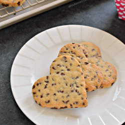 """Nothing says I love you like a warm from the oven chocolate chip cookie. Except, of course, when it comes in the shape of a heart. These heart shaped chocolate chip cookies are the perfect way to say """"I love you"""" this Valentine's Day or any day of the year."""
