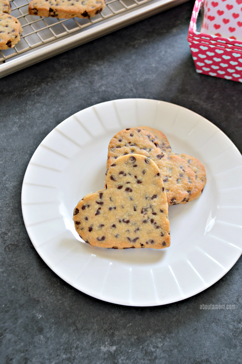 1 cup unsalted butter, softened ⅓ cup granulated sugar ½ cup light-brown sugar 1 large egg yolk 2 tsp vanilla extract 2 ½ cups all-purpose flour ½ tsp salt 1 ½ cups semi-sweet mini-chocolate chips