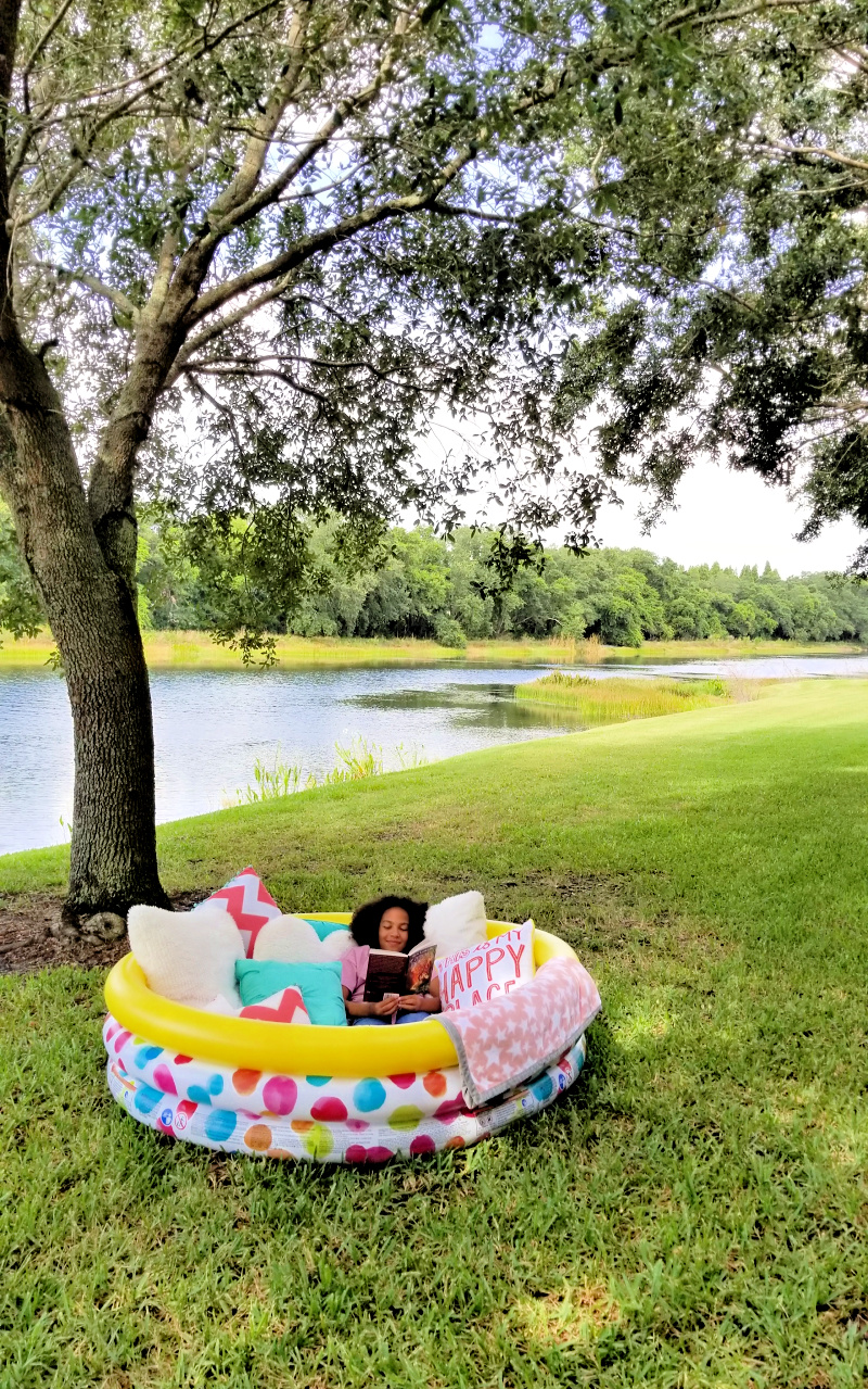 There's nothing dreamier than spending the summer outdoors with a good book. This DIY outdoor reading nook comes together easily with a kiddie pool, some blankets and pillows. It's a perfect, comfy reading fort where kids can read the Percy Jackson & the Olympians series.