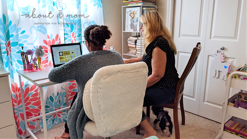 mother helping child with virtual learning
