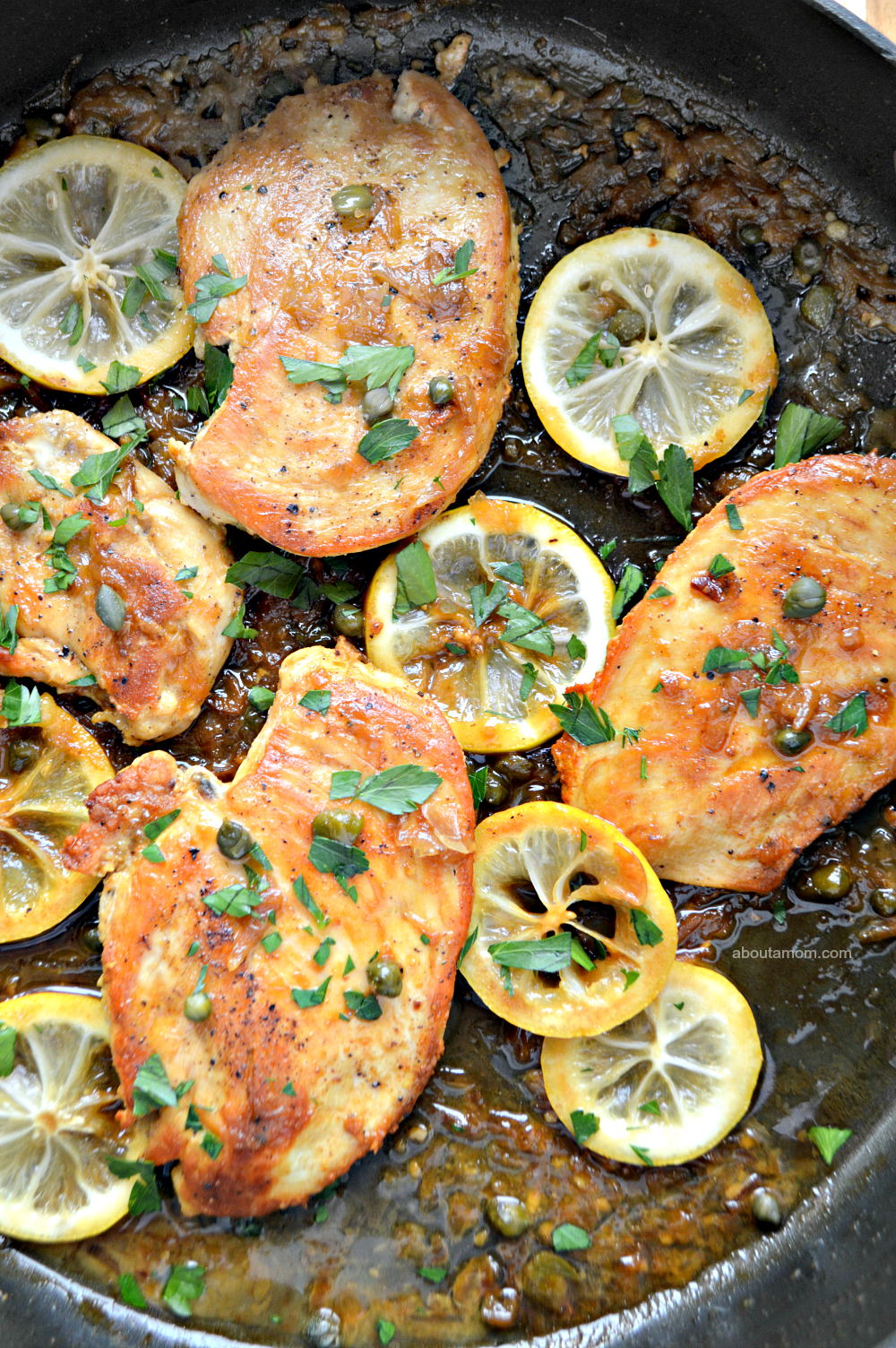 Sauteed chicken in a buttery lemon sauce with caper and sliced lemon. This flavorful skillet lemon chicken recipe comes together quickly and is perfect for a busy weeknight.