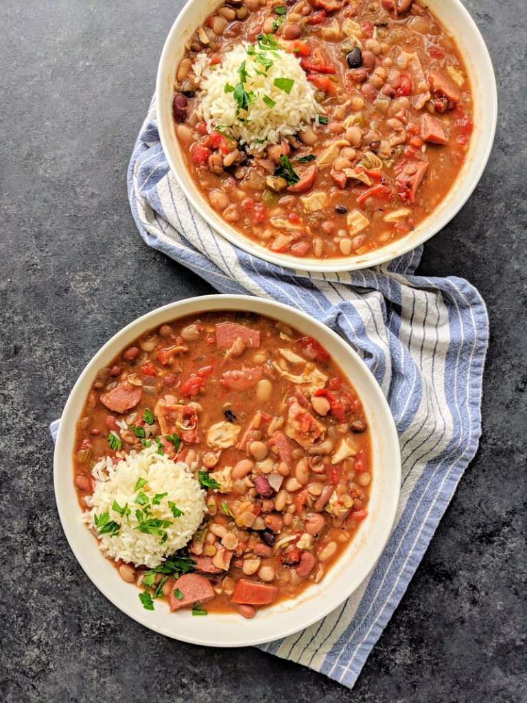 Slow Cooker Cajun 15 Bean Soup with Sausage, Chicken and Bacon - A flavorful and hearty Cajun 15 bean soup that will everyone will love, made easy in the slow cooker! This slow cooker 15 bean soup is perfect for game day, winter nights or anytime you crave comfort food.