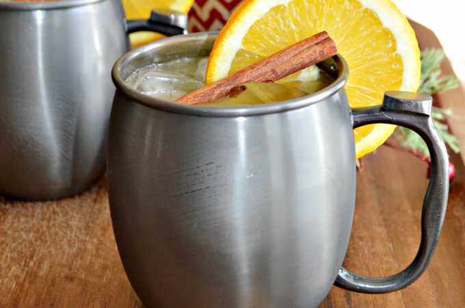 This Spiced Orange Moscow Mule cocktail is the perfect, festive drink for your holiday gatherings. The delicious holiday cocktail comes together easily and is made with orange juice, vodka, ginger beer and a simple syrup spiced with whole cloves and cinnamon sticks.