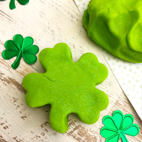 St. Patrick's Day Playdough. This glittery green homemade playdough recipe is a fun St. Patrick's Day activity for kids.