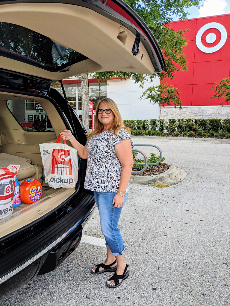 woman picking up fabric care products at target