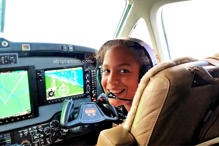 Girl co-piloting a jet.