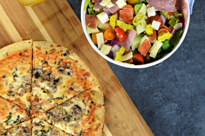 Seriously, this salad rivals any Italian Chopped Salad you could get in a restaurant. This hearty salad is loaded with great flavors and textures. The easy homemade Italian vinaigrette makes this salad addicting. You're family is going to love this one and it perfectly pairs with American Flatbread Pizza!