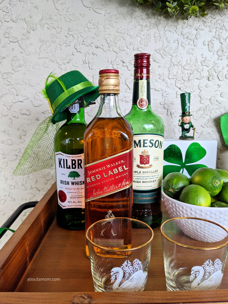 Bar cart styling ideas for St. Patrick's Day. Celebrate March 17th at home in style with this St. Patrick's Day bar cart makeover. See how to style a bar cart for St. Patrick's Day in a way that is fun, simple and won't break the bank. Perfect for a relaxing evening of drinks or Saint Patrick's Day party with family and friends.
