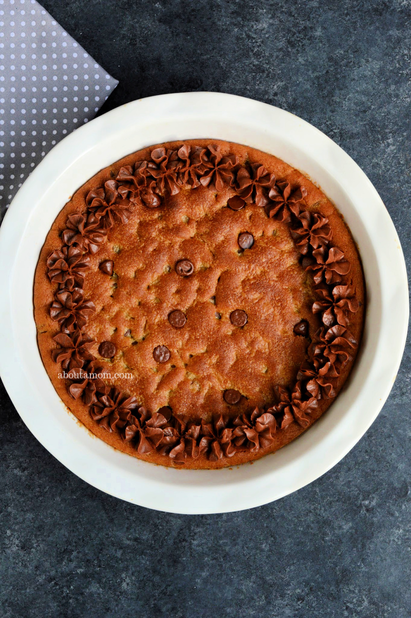 It doesn't get much better or easier than a soft and chewy chocolate chip cookie that is baked in a pie dish. Decorate this giant chocolate chip cookie pie with chocolate frosting, then slice and serve warm with a scoop of vanilla ice cream and a chocolate drizzle. Mmmm.