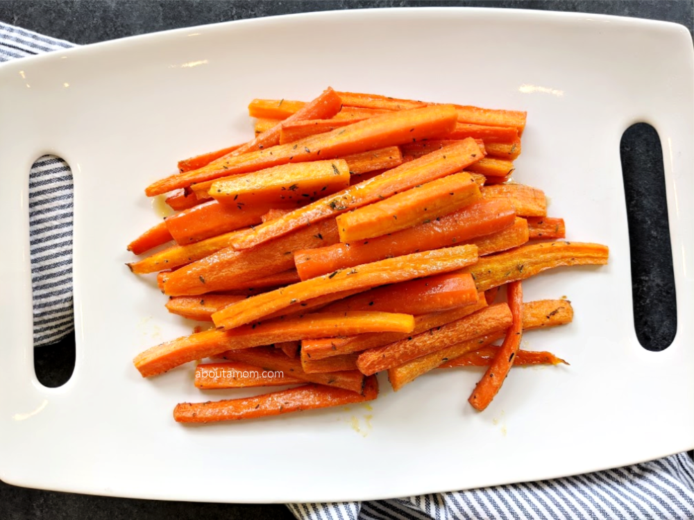 This roasted honey glazed carrots recipe is an easy way to enjoy carrots. It's one of those easy vegetable side dish recipes that I find myself making time and time again. Carrots tossed in a sweet, sticky glaze and roasted in the oven until fork tender and caramelized. Honey and butter make everything good. Even your picky eaters will love this vegetable side dish.