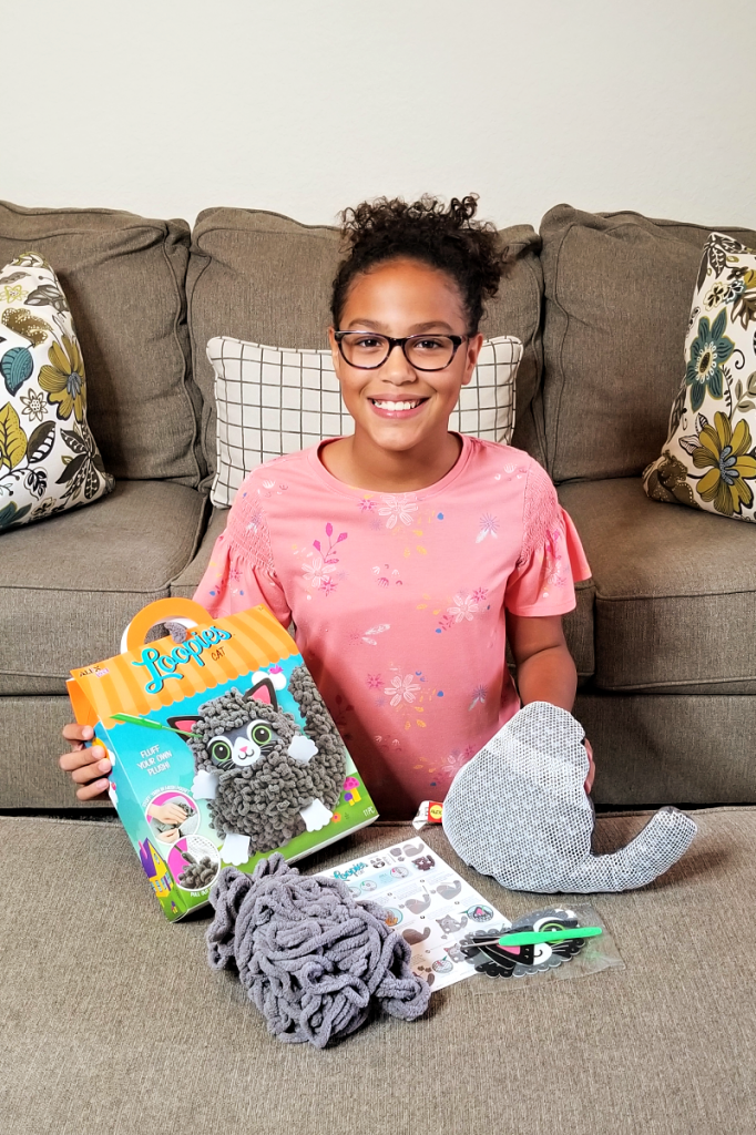 Loopies from Alex Toys are a fun way for kids to make their own cute plush character. The pre-sewn plush characters feature a mesh pocket that you and your child can fill with soft Chenille yarn, then pull out loops using a crochet hook - creating a personalized look for your fluffy friend!