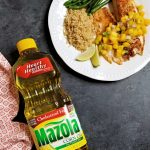 This grilled tilapia recipe is a must for your summer grilling. Lighten up your summer with delicious grilled tilapia topped with a fresh pineapple mango salsa. You can't beat a fresh juicy pineapple, and the mango puts this grilled fish and tropical salsa recipe over the top. Diced jalapeno adds just the right amount of kick to this light, refreshing summertime meal. It's a simple grilled fish recipe that takes little time to prepare. Using Mazola Corn Oil instead of butter really lightens up and enhances this recipe.