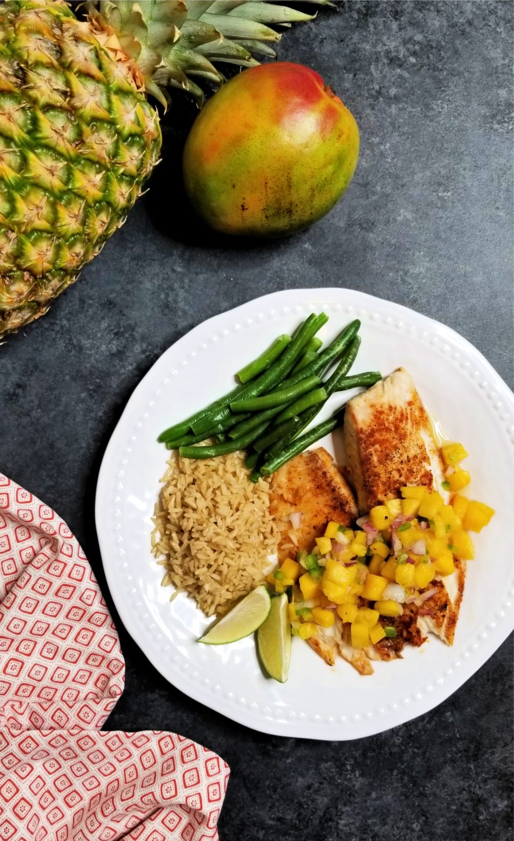 This grilled tilapia recipe is a must for your summer grilling. Lighten up your summer with delicious grilled tilapia topped with a fresh pineapple mango salsa. You can't beat a fresh juicy pineapple, and the mango puts this grilled fish and tropical salsa recipe over the top. Diced jalapeno adds just the right amount of kick to this light, refreshing summertime meal. It's a simple grilled fish recipe that takes little time to prepare.