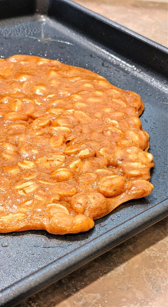 spread peanut brittle onto pan