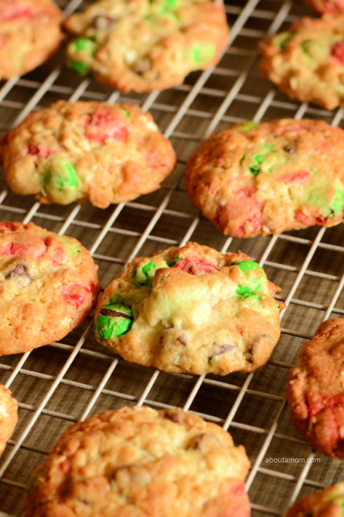 Christmas Monster Cookies are thick, chewy,soft and filled with festive surprises. These are insanely delicious and go perfectly with a tall glass of milk. Even better, they are incredibly simple to make. This is a fun holiday twist on the traditional monster cookie.