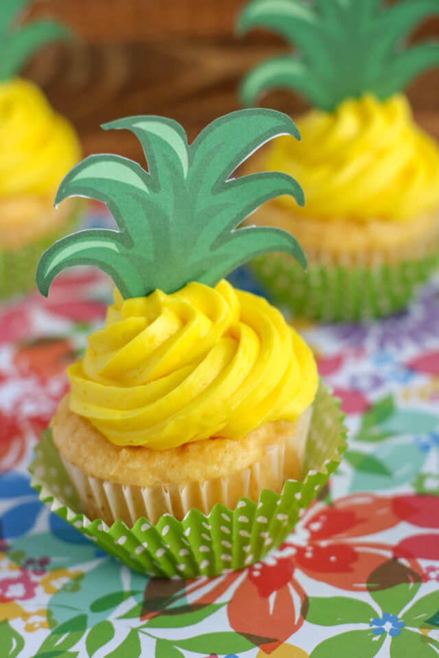 These pineapple cupcakes are moist delicious cupcakes that look just like little pineapples. Using yellow frosting and the printable pineapple topper, these summer cupcakes have a tropical flare and are perfect for a picnic or party.