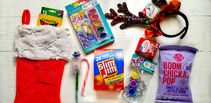 Movie Night, Game Night, and Arts & Crafts Night themed stocking stuffer ideas for kids. The holidays are here, which means gift-giving season is upon us! While it's crucial to get all those must-have gifts and gadgets for your little ones, don't forget about the stocking stuffers! Little things mean a lot which is why this year I'm putting some extra effort into choosing stocking stuffers for my family. I'll be filling their stockings with Slim Jim - the perfect on-the-go snack that everyone can agree on. Slim Jim gives that perfect pick-me-up boost without the sugar crash later.