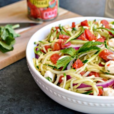 This zucchini noodle salad with tomatoes is a simple-to-make and flavorful side dish. It's a dish you'll be making all summer long.