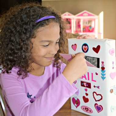 Make Valentine's Day more fun for kids with these colorful Fruity Pebbles Valentines and a cereal box mailbox to collectall your Valentine's Day cards.