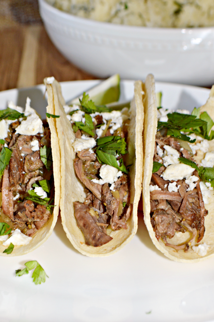 Taco night just got a whole lot better! This slow cooker salsa verde beef tacos recipe couldn't be any easier to prepare, and is sure to be a meal your family asks for again and again.