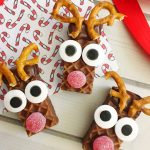 This cute Christmas treat takes a few simple ingredients and turns a store bought snack into Rudolph. These Rudolph Nutty Bars will make everyone smile